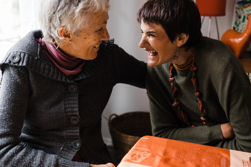 n elderly woman and her daughter, who has angelmans syndrome, share an affectionate moment